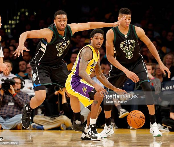 Jabari Parker of the Milwaukee Bucks and Giannis Antetokounmpo of the Milwaukee Bucks defend against Louis Williams of the Los Angeles Lakers during...