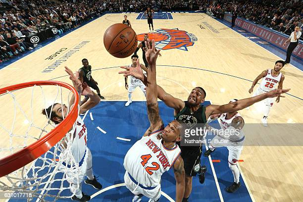 Jabari Parker of the Milwaukee Bucks and Lance Thomas of the New York Knicks fight for the rebound on January 4 2017 at Madison Square Garden in New...