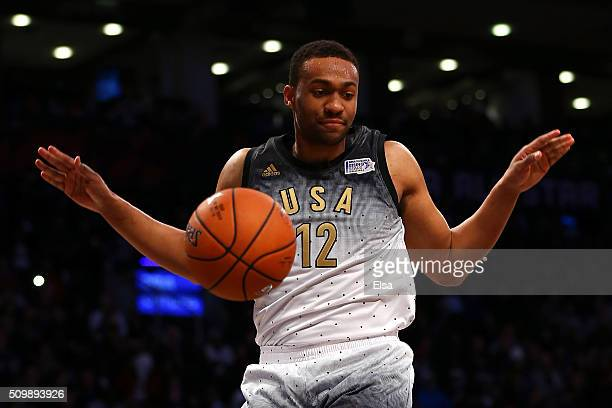 Jabari Parker of the Milwaukee Bucks and the United States team dunks in the second half against the World team during the BBVA Compass Rising Stars...