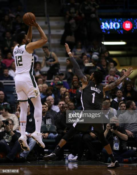 Jabari Parker of the Milwaukee Bucks attempts a shot while being guarded by D'Angelo Russell of the Brooklyn Nets in the first quarter at the Bradley...