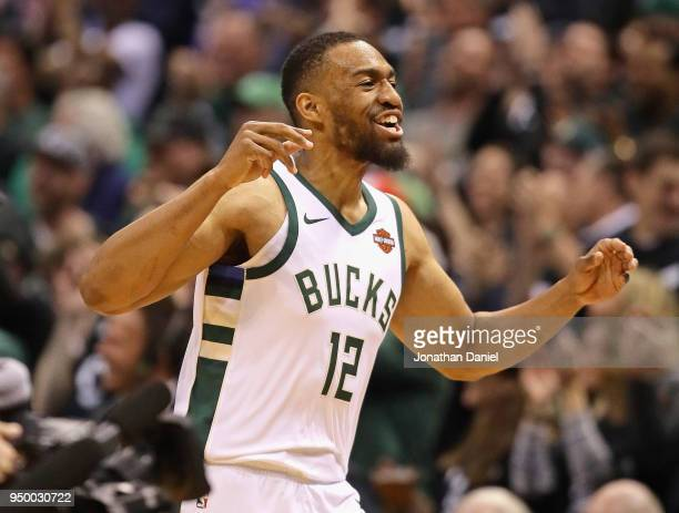 Jabari Parker of the Milwaukee Bucks celebrates after hitting a shot against the Boston Celtics during Game Four of Round One of the 2018 NBA...