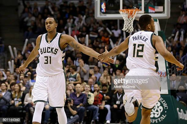 Jabari Parker of the Milwaukee Bucks celebrates with John Henson after making a basket during the third quarter against the Golden State Warriors at...