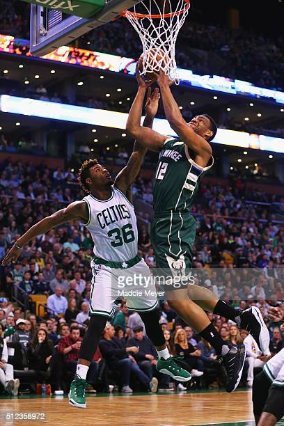 Jabari Parker of the Milwaukee Bucks draws a foul from Marcus Smart of the Boston Celtics during the first quarter at TD Garden on February 25 2016...