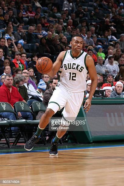 Jabari Parker of the Milwaukee Bucks dribbles the ball against the Philadelphia 76ers on December 23 2015 at the BMO Harris Bradley Center in...