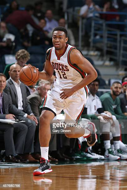 Jabari Parker of the Milwaukee Bucks drives to the basket against the Minnesota Timberwolves during the game on October 22 2014 at the BMO Harris...