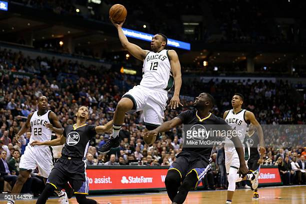 Jabari Parker of the Milwaukee Bucks drives to the hoop for two points during the third quarter against the Golden State Warriors during the third...