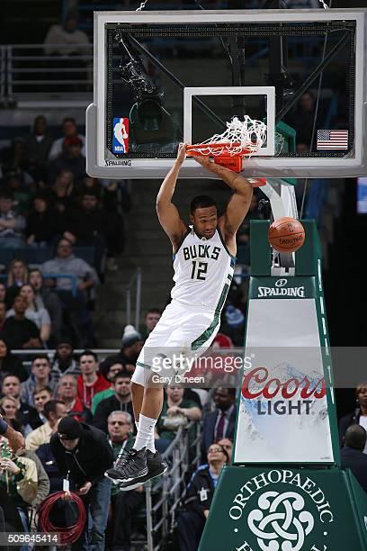 Jabari Parker of the Milwaukee Bucks dunks against the Washington Wizards on February 11 2016 at the BMO Harris Bradley Center in Milwaukee Wisconsin...