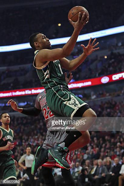 Jabari Parker of the Milwaukee Bucks goes up for a shot past Taj Gibson of the Chicago Bulls at the United Center on January 5 2016 in Chicago...