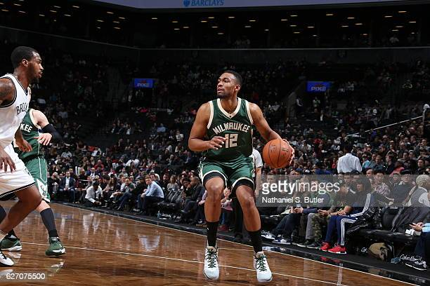 Jabari Parker of the Milwaukee Bucks handles the ball against the Brooklyn Nets on December 1 2016 at Barclays Center in Brooklyn New York NOTE TO...