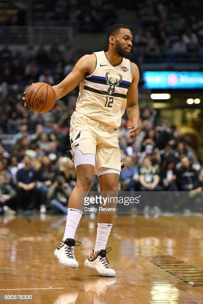 Jabari Parker of the Milwaukee Bucks handles the ball during a game against the New York Knicks at the Bradley Center on March 9 2018 in Milwaukee...