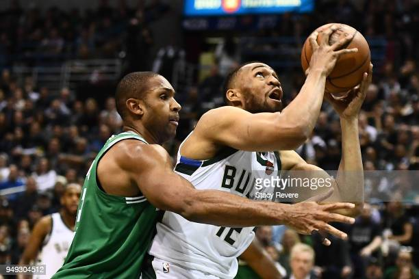 Jabari Parker of the Milwaukee Bucks is defended by Al Horford of the Boston Celtics during the second half of game three of round one of the Eastern...