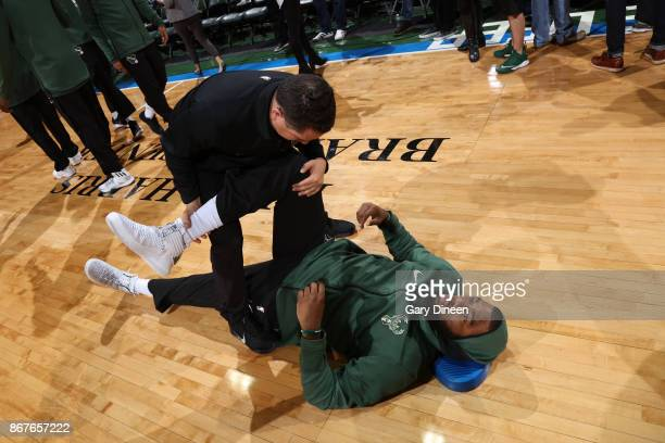 Jabari Parker of the Milwaukee Bucks is stretched prior to the game against the Cleveland Cavaliers on October 20 2017 at the BMO Harris Bradley...