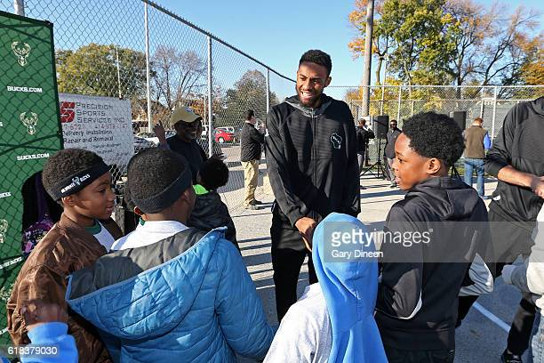Jabari Parker of the Milwaukee Bucks joins up with community groups and Precision Sports to refurbish outdoor public basketball courts at Mitchell...