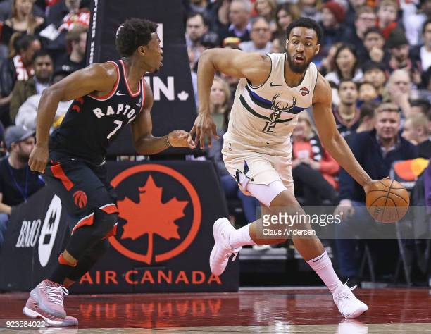 Jabari Parker of the Milwaukee Bucks plays against Kyle Lowry of the Toronto Raptors in an NBA game at the Air Canada Centre on February 23 2018 in...