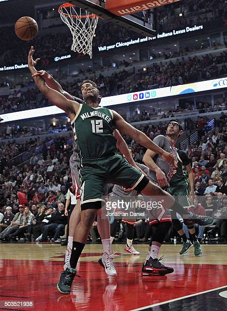 Jabari Parker of the Milwaukee Bucks puts up a shpot around Pau Gasol of the Chicago Bulls at the United Center on January 5 2016 in Chicago Illinois...