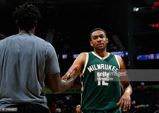 Jabari Parker of the Milwaukee Bucks reacts after a basket in the second overtime of their 117109 win over the Atlanta Hawks at Philips Arena on...