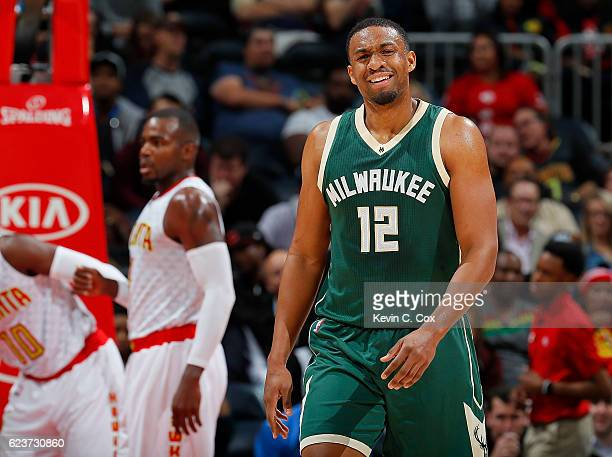 Jabari Parker of the Milwaukee Bucks reacts after being charged with a foul against the Atlanta Hawks at Philips Arena on November 16 2016 in Atlanta...