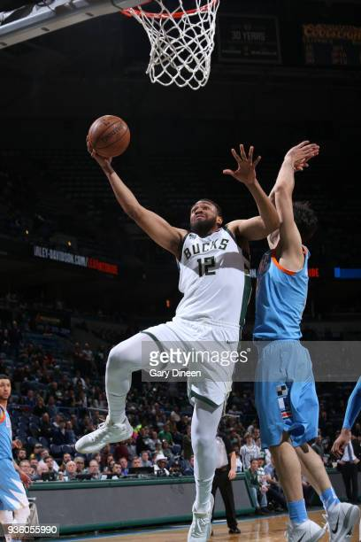 Jabari Parker of the Milwaukee Bucks shoots against Milos Teodosic of the Los Angeles Clippers during the NBA game on March 21 2018 at the BMO Harris...
