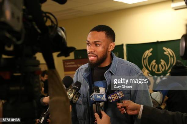Jabari Parker of the Milwaukee Bucks talks to the media during the distribution of Thanksgiving dinner baskets on November 21 2017 at the House of...