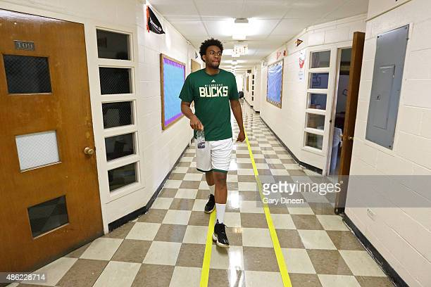 Jabari Parker of the Milwaukee Bucks visits his former school with his former grade school teacher Clintonia McNeal as part of the TeachersCount...