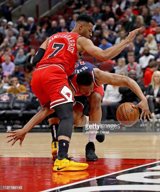 Jabari Parker of the Washington Wizards slips as he moves against Timothe LuwawuCabarrot of the Chicago Bulls at the United Center on March 20 2019...