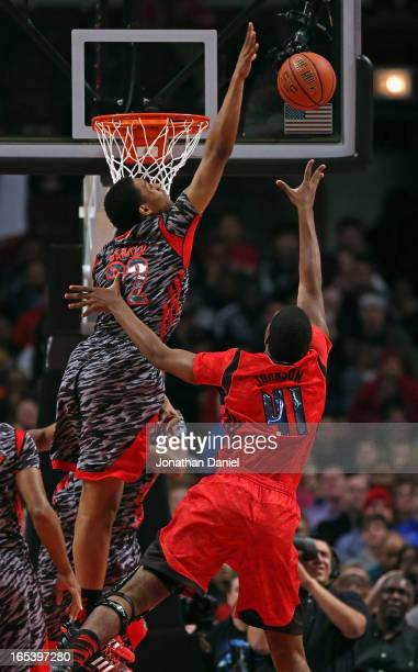 Jabari Parker of the West blocks a shot by Dakari Johnson of the East during the 2013 McDonald's All American game at United Center on April 3 2013...