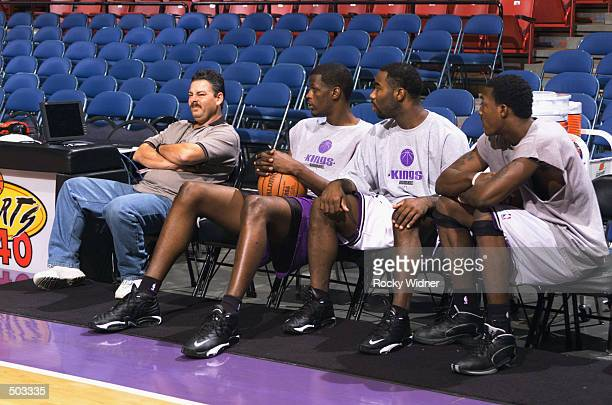 Jabari Smith, Mateen Cleaves, and Gerald Wallace of the Sacramento Kings watch football on TV before their game against the Dallas Mavericks at Arco...
