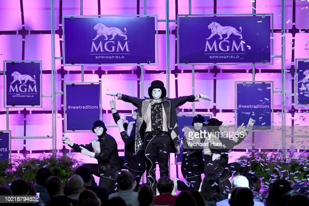 Jabbawockeez perform onstage during MGM Resorts International's Grand Opening Press Conference as the $960 Million MGM Springfield debuts on August...