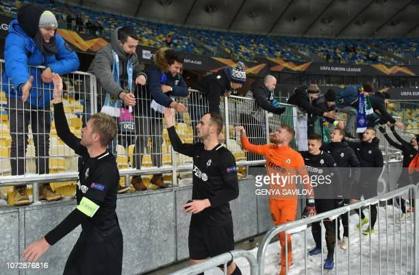 Jablonec's players greet supporters after the UEFA Europa League Group K football match between Dynamo Kiev and Jablonec at the Olympiyski stadium in...