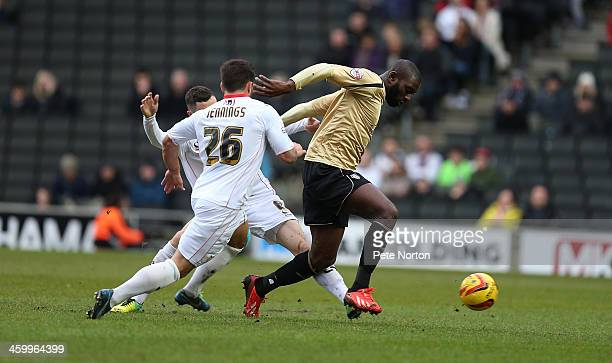 Jabo Ibehre of Colchester United attempts to move away from Darren Potter and Dale Jennings of Milton Keynes Dons during the Sky Bet League One match...
