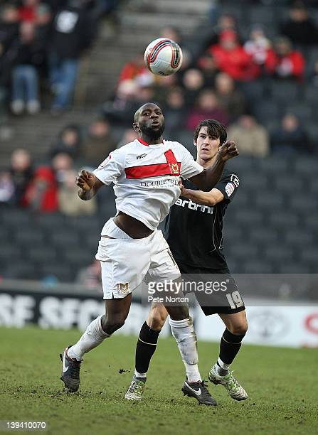 Jabo Ibehre of MK Dons looks to control the ball under pressure from Kieran Lee of Oldham Athletic during the npower League One match between MK Dons...