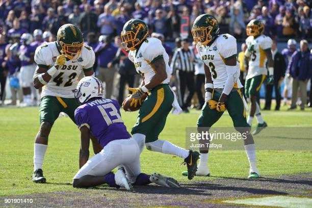 Jabril Cox Marquise Bridges and Tre Dempsey of North Dakota State University celebrate after Bridges intercepted a pass from Ishmael Hyman of James...