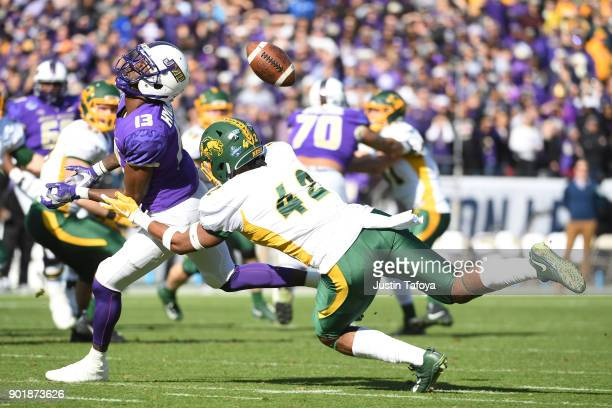 Jabril Cox of North Dakota State University blocks a pass intended for Ishmael Hyman of James Madison University during the Division I FCS Football...