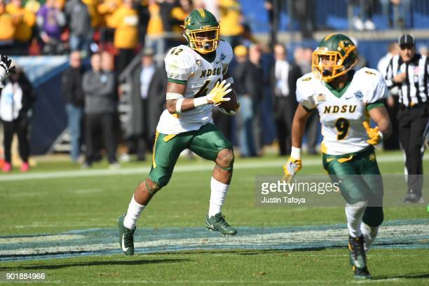 Jabril Cox of North Dakota State University returns a James Madison University turnover during the Division I FCS Football Championship held at...