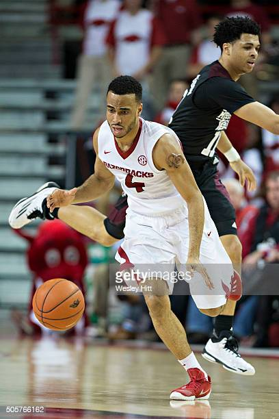 Jabril Durham of the Arkansas Razorbacks dribbles the ball down the court during a game against the Mississippi State Bulldogs at Bud Walton Arena on...