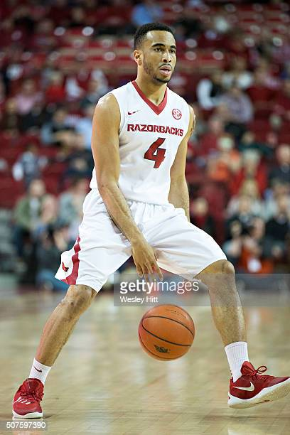 Jabril Durham of the Arkansas Razorbacks dribbles the ball down the court during a game against the Texas AM Aggies at Bud Walton Arena on January 27...
