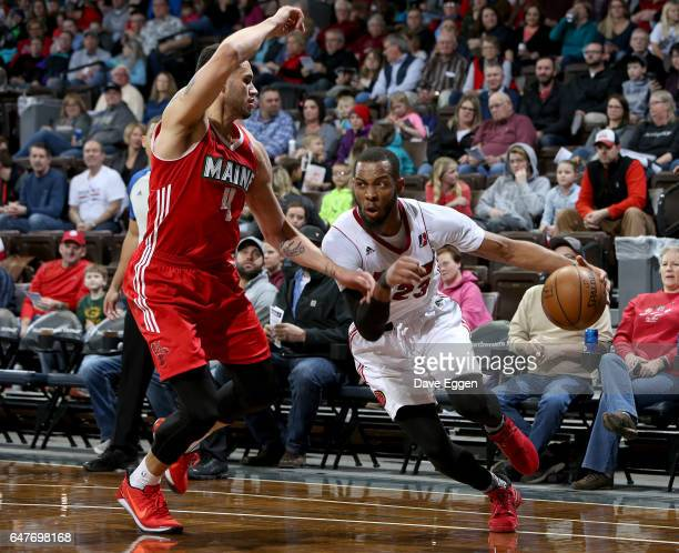Jabril Trawick from the Sioux Falls Skyforce drives past Abdel Nader from the Maine Red Claws at the Sanford Pentagon March 3 2017 in Sioux Falls...