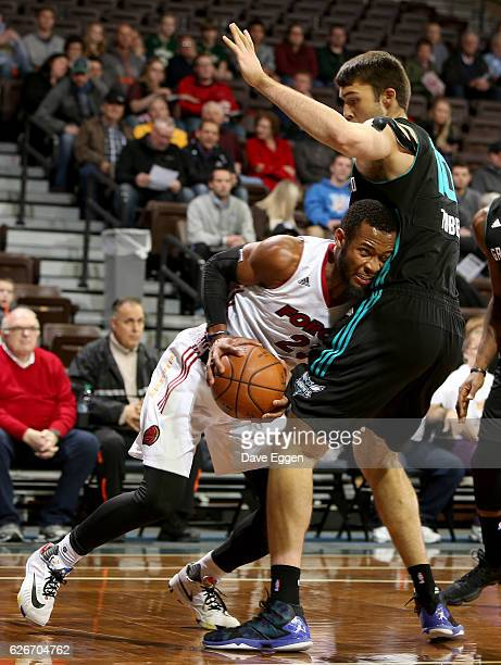 Jabril Trawick from the Sioux Falls Skyforce drives to the basket against Mike Tobey from the Greensboro Swarm at the Sanford Pentagon November 29...
