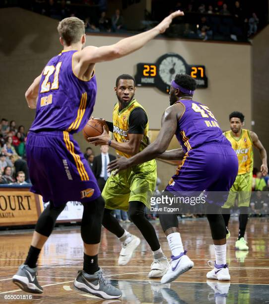 Jabril Trawick from the Sioux Falls Skyforce looks for a teammate between a pair of defenders including DeJuan Blair from the Los Angeles DFenders at...