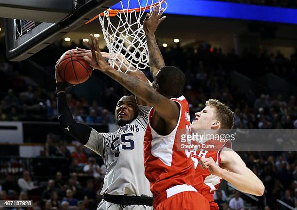 Jabril Trawick of the Georgetown Hoyas goes up against Delon Wright and Jakob Poeltl of the Utah Utes in the first half during the third round of the...