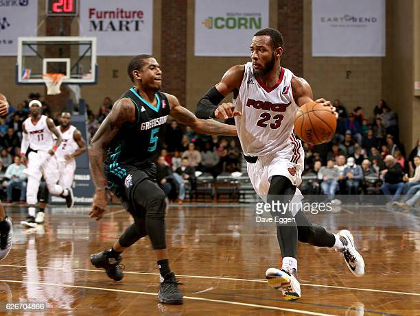 Jabril Trawick of the Sioux Falls Skyforce pushes the ball past Xavier Munford from the Greensboro Swarm at the Sanford Pentagon November 29 2016 in...