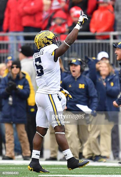 Jabrill Peppers of the Michigan Wolverines celebrates after intercepting a pass by JT Barrett of the Ohio State Buckeyes during the second half of...