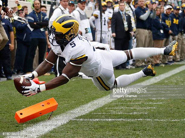 Jabrill Peppers of the Michigan Wolverines dives for a first quarter touchdown while playing the Michigan State Spartans at Spartan Stadium on...