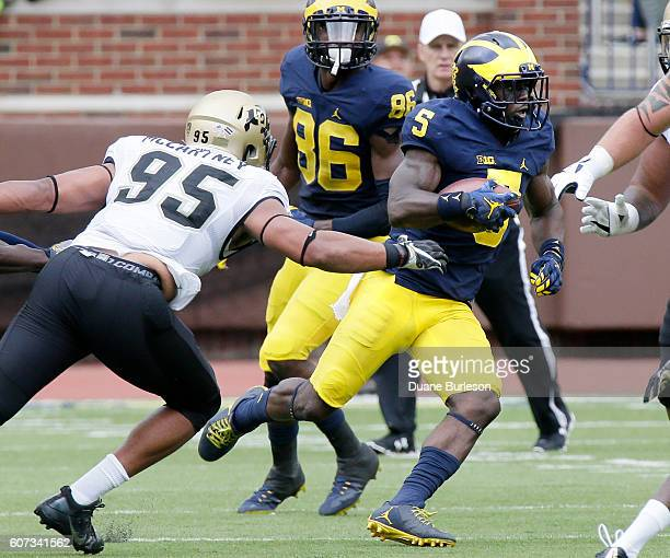 Jabrill Peppers of the Michigan Wolverines is pursued by Derek McCartney of the Colorado Buffaloes during the first half at Michigan Stadium on...