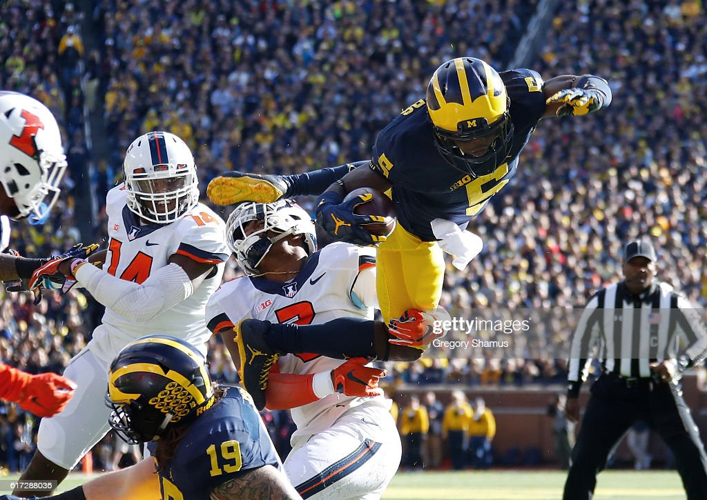 Jabrill Peppers #5 of the Michigan Wolverines jumps over Julian Jones #2 of the Illinois Fighting Illini during a first quarter run on October 22, 2016 at Michigan Stadium in Ann Arbor, Michigan.
