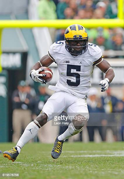 Jabrill Peppers of the Michigan Wolverines runs for a first down during the second quarter of the game against the Michigan State Spartans at Spartan...