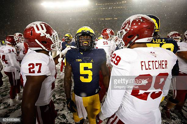 Jabrill Peppers of the Michigan Wolverines talks after a 2010 win with Dawson Fletcher of the Indiana Hoosiers and Arthur Jones of the Indiana...