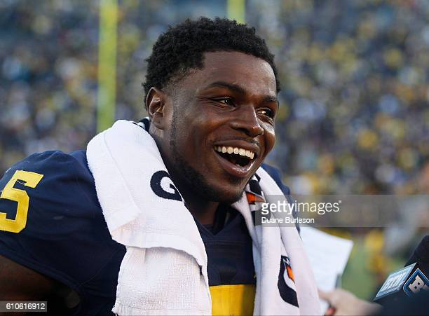 Jabrill Peppers smiles while being interviewed following a game against the Colorado Buffaloes at Michigan Stadium on September 17 2016 in Ann Arbor...