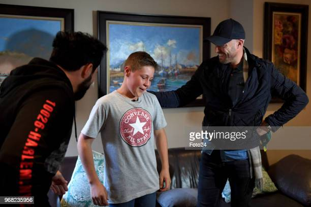 Jacaranda FM DJ Martin Bester 14yearold Leo Sadler with his role model AB de Villiers at his home during an arranged surprise meeting on June 05 2018...