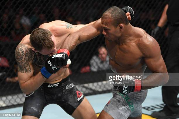 Jacare Souza of Brazil punches Jack Hermansson of Sweden in their middleweight bout during the UFC Fight Night event at BBT Center on April 27 2019...